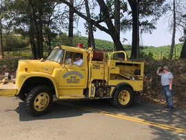 Fred Schweiger's yellow fire truck working on Spring Mountain Road